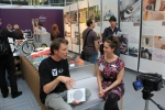 Kellie Hill speaking to designer of Northumbria Uni stand ND Winner
