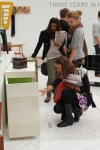 Visitors looking at cabinet New Designers 2011