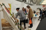Visitors looking at designs New Designers 2011